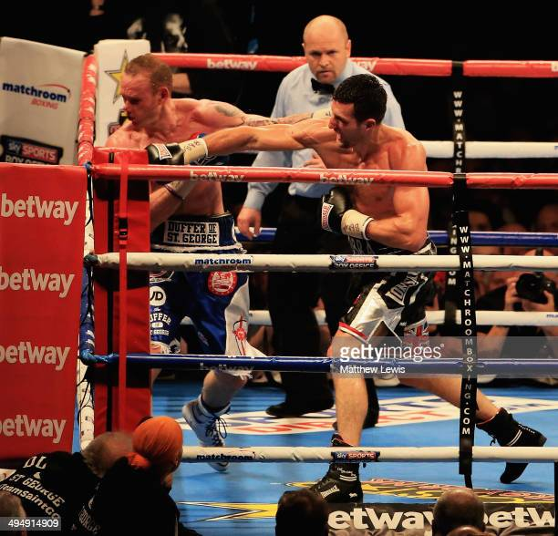 Carl Froch knocks out George Groves during the IBF WBA World Super Middleweight Title Fight at Wembley Stadium on May 31 2014 in London England
