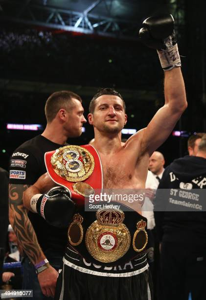 Carl Froch of England celebrates his victory against George Groves of England during their IBF and WBA World Super Middleweight title fight at...