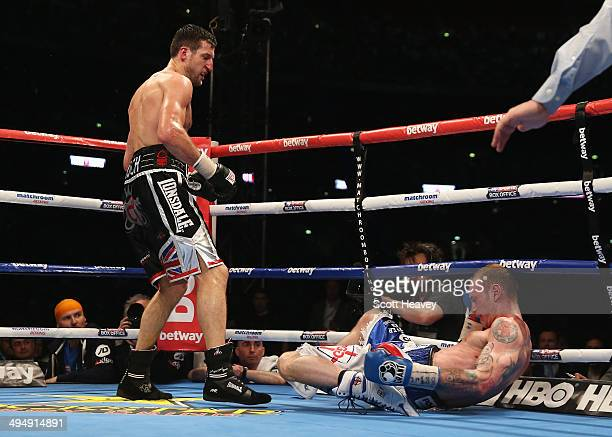Carl Froch of England floors George Groves of England to win their IBF and WBA World Super Middleweight title fight at Wembley Stadium on May 31 2014...