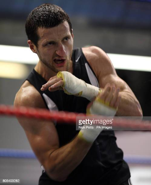 Carl Froch shadow boxes during a photocall at the Liberty Gym Nottingham