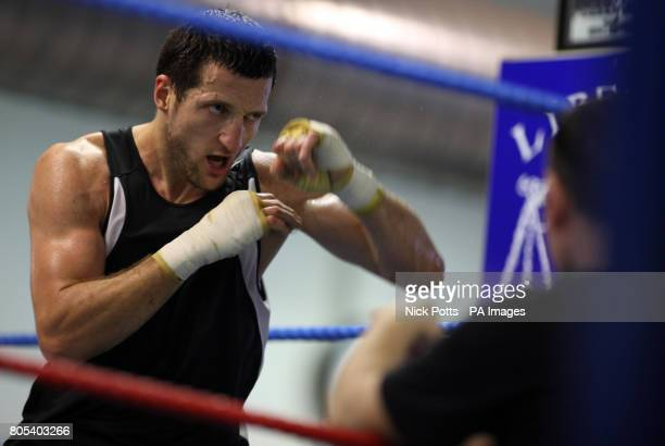 Carl Froch shadow boxes watched by coach Robert McCracken during a photocall at the Liberty Gym Nottingham