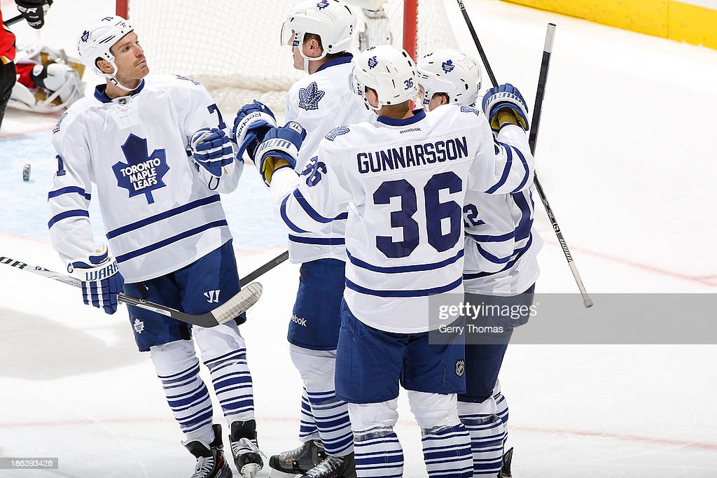 <a gi-track='captionPersonalityLinkClicked' href=/galleries/search?phrase=Carl+Gunnarsson&family=editorial&specificpeople=5557315 ng-click='$event.stopPropagation()'>Carl Gunnarsson</a> #36 and David Clarkson #71 of the Toronto Maple Leafs celebrate a goal against the Calgary Flames at Scotiabank Saddledome on October 30, 2013 in Calgary, Alberta, Canada.
