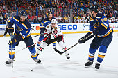 Carl Gunnarsson and Kevin Shattenkirk of the St Louis Blues control the puck against Teuvo Teravainen of the Chicago Blackhawks at the Scottrade...