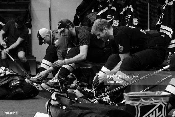 Carl Gunnarsson Joel Edmundson and Colton Parayko of the St Louis Blues get ready for warmups prior to a game against the Minnesota Wild in Game Four...