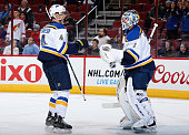 Carl Gunnarsson of the St Louis Blues congratulates goaltender Brian Elliott after defeating the Arizona Coyotes 60 in the NHL game at Gila River...