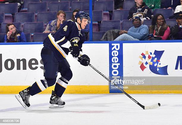 Carl Gunnarsson of the St Louis Blues handles the puck against the Anaheim Ducks on October 30 2014 at Scottrade Center in St Louis Missouri
