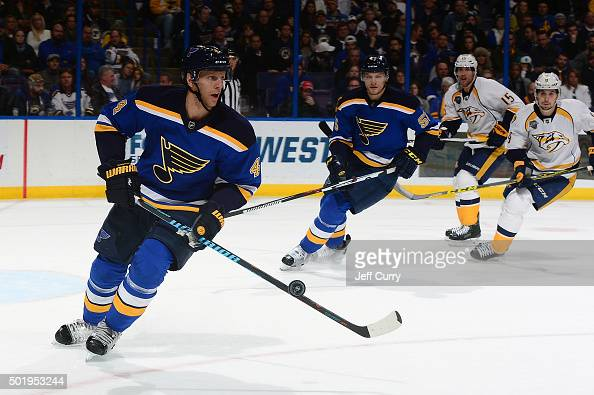 Carl Gunnarsson of the St Louis Blues handles the puck against the Nashville Predators on December 17 2015 at Scottrade Center in St Louis Missouri