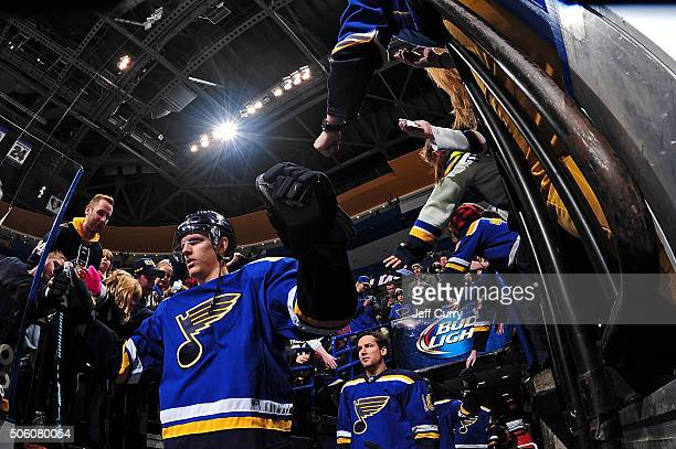 Carl Gunnarsson of the St Louis Blues high fives fans before a game against the Nashville Predators on December 29 2015 at Scottrade Center in St...