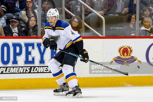 Carl Gunnarsson of the St Louis Blues keeps an eye on the play during first period action against the Winnipeg Jets at the MTS Centre on October 18...