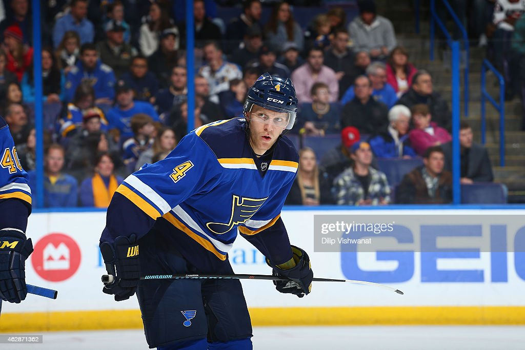 Carl Gunnarsson of the St Louis Blues lines up for a faceoff against the Toronto Maple Leafs at the Scottrade Center on January 17 2015 in St Louis...