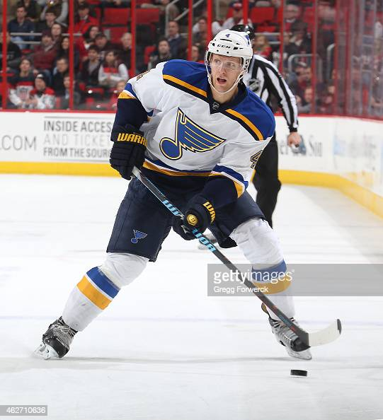 Carl Gunnarsson of the St Louis Blues skates with the puck during their NHL game against the Carolina Hurricanes at PNC Arena on January 30 2015 in...