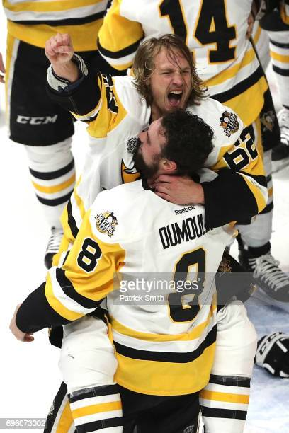 Carl Hagelin and Brian Dumoulin of the Pittsburgh Penguins celebrate after they defeated the Nashville Predators to win the 2017 NHL Stanley Cup...