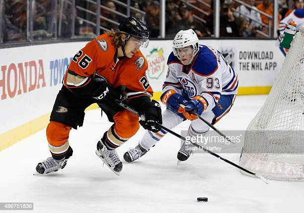 Carl Hagelin of the Anaheim Ducks skates with the puck as Ryan NugentHopkins of the Edmonton Oilers pursues during the first period of a game at...