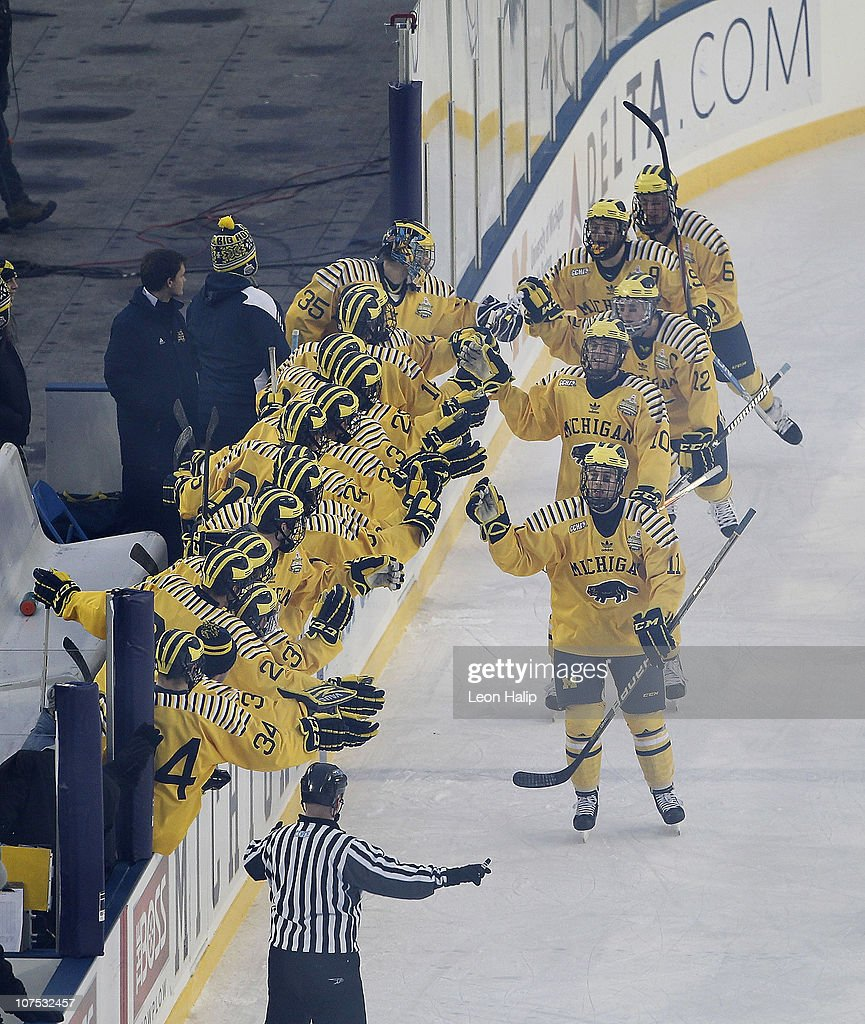 Carl Hagelin #12 of the Michigan Wolverines celebrates with his teammates after scoring in the second period of the Big Chill game between the Michigan State Spartans and the Michigan Wolverines at Michigan Stadium on December 11, 2010 in Ann Arbor, Michigan. The Wolverines defeated the Spartand 5-0. (Photo by Leon Halip/Getty Images) 113411