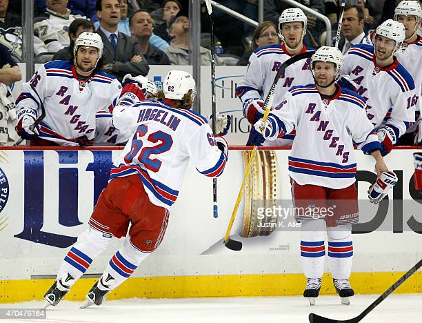 Carl Hagelin of the New York Rangers celebrates after scoring past MarcAndre Fleury of the Pittsburgh Penguins in Game Three of the Eastern...