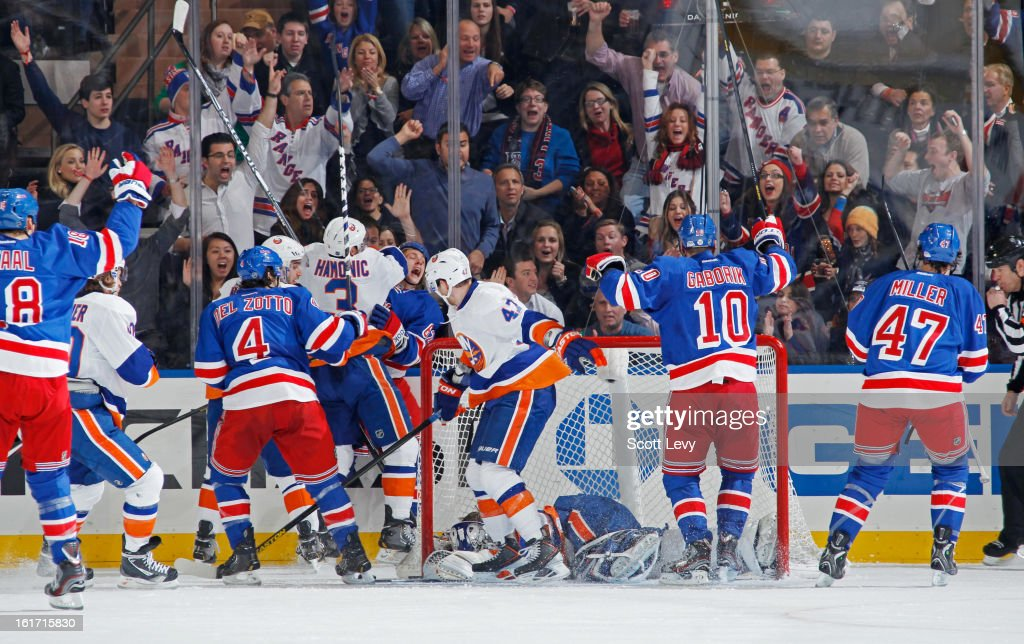 Carl Hagelin #62 of the New York Rangers celebrates his goal in the second period against Evgeni Nabokov #20 of the New York Islanders at Madison Square Garden on February 14, 2013 in New York City.