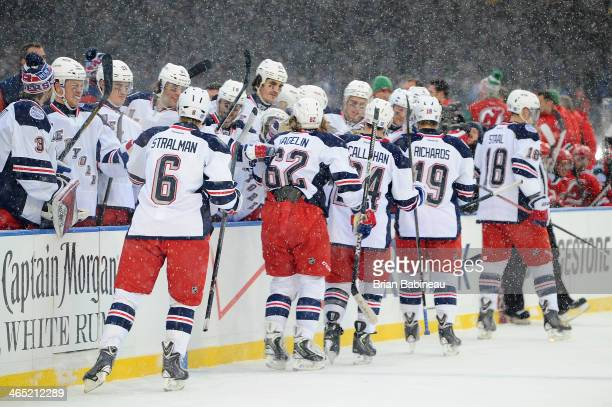 Carl Hagelin of the New York Rangers celebrates with his teammates after scoring against the New Jersey Devils in the second period of the 2014 Coors...