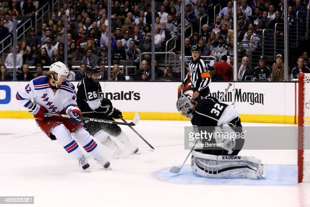 Carl Hagelin of the New York Rangers scores a goal that bounced off Slava Voynov of the Los Angeles Kings in the first period during Game One of the...