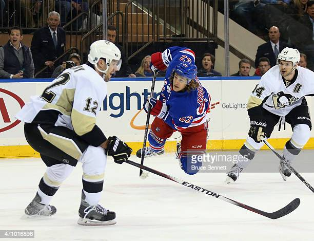 Carl Hagelin of the New York Rangers scores the game winning goal at 1052 of overtime against the Pittsburgh Penguins in Game Five of the Eastern...
