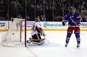 Carl Hagelin of the New York Rangers scores the game winning goal against Craig Anderson of the Ottawa Senators to defeat the Ottawa Senators in...