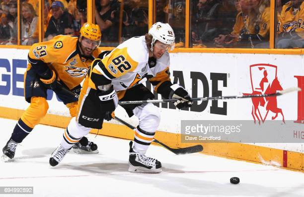 Carl Hagelin of the Pittsburgh Penguins and Roman Josi of the Nashville Predators chase the puck during the second period of Game Six of the 2017 NHL...