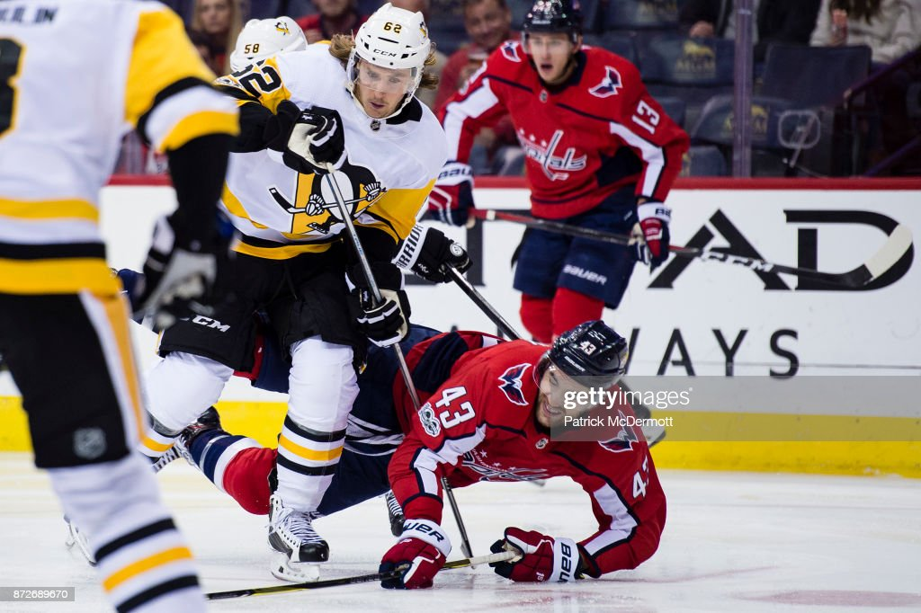 Carl Hagelin #62 of the Pittsburgh Penguins and Tom Wilson #43 of the Washington Capitals collide in the third period at Capital One Arena on November 10, 2017 in Washington, DC.