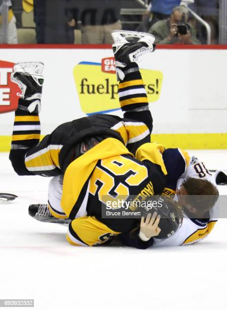 Carl Hagelin of the Pittsburgh Penguins and Viktor Arvidsson of the Nashville Predators fight in the third period in Game Five of the 2017 NHL...