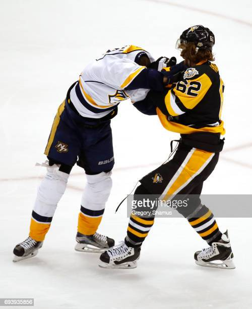 Carl Hagelin of the Pittsburgh Penguins and Viktor Arvidsson of the Nashville Predators fight during the third period in Game Five of the 2017 NHL...