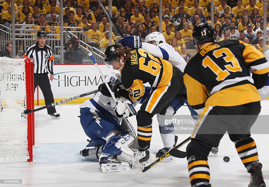<a gi-track='captionPersonalityLinkClicked' href=/galleries/search?phrase=Carl+Hagelin&family=editorial&specificpeople=4465394 ng-click='$event.stopPropagation()'>Carl Hagelin</a> #62 of the Pittsburgh Penguins battles for the loose puck in front of <a gi-track='captionPersonalityLinkClicked' href=/galleries/search?phrase=Andrei+Vasilevskiy+-+Ishockeyspelare&family=editorial&specificpeople=9594320 ng-click='$event.stopPropagation()'>Andrei Vasilevskiy</a> #88 of the Tampa Bay Lightning in Game Seven of the Eastern Conference Final during the 2016 NHL Stanley Cup Playoffs at Consol Energy Center on May 26, 2016 in Pittsburgh, Pennsylvania.