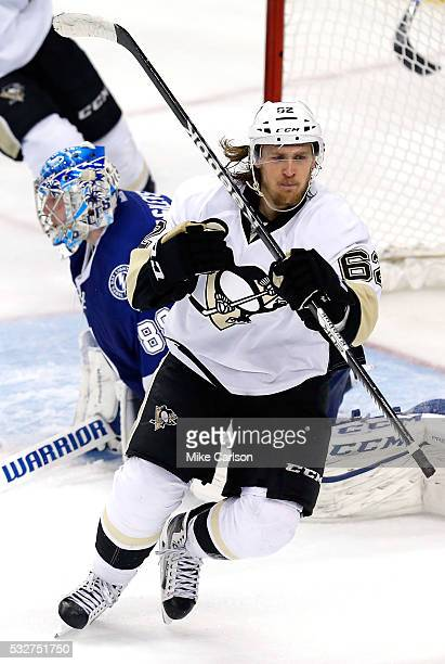 Carl Hagelin of the Pittsburgh Penguins celebrates after scoring a goal during the second period against Andrei Vasilevskiy of the Tampa Bay...