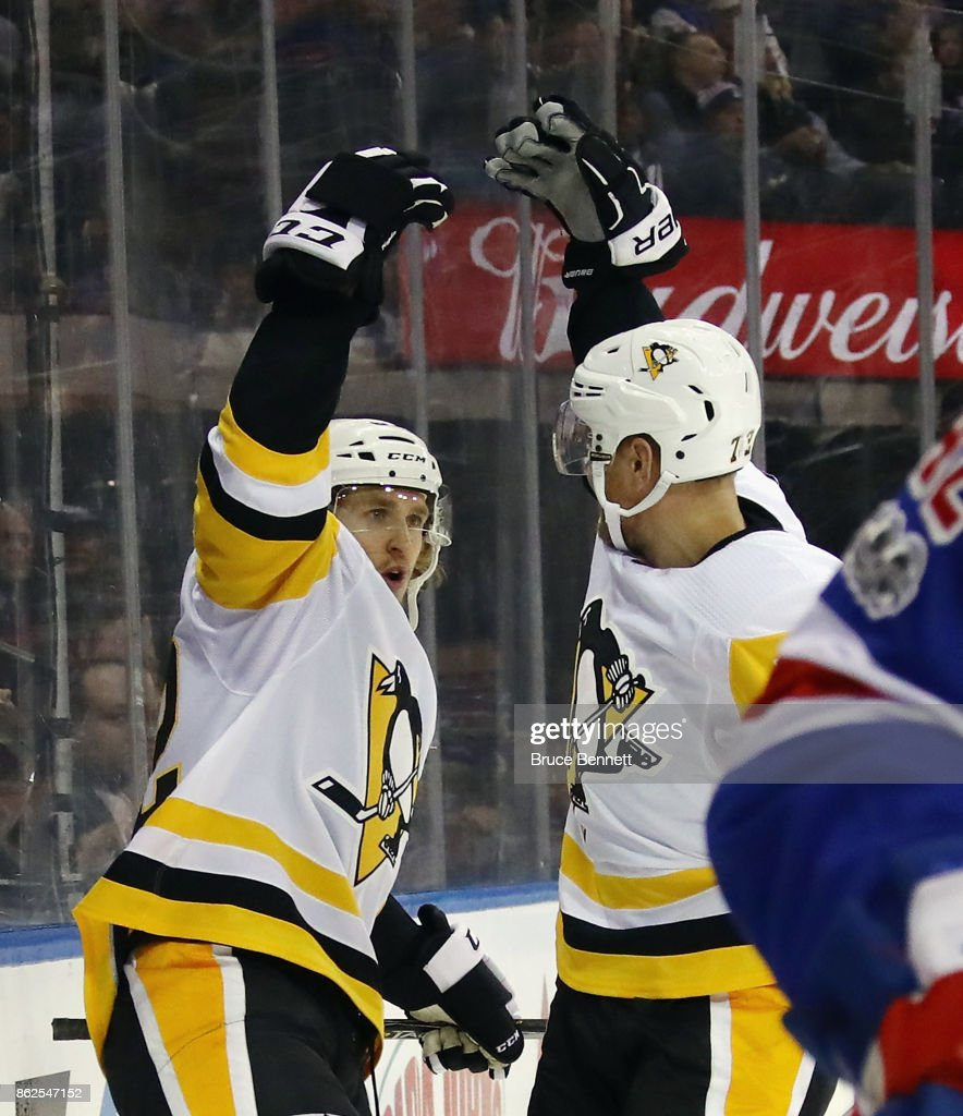 Carl Hagelin #62 of the Pittsburgh Penguins (l) celebrates his goal at 13:30 of the first period against the New York Rangers and is joined by Patric Hornqvist #72 (r) at Madison Square Garden on October 17, 2017 in New York City.