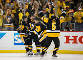Carl Hagelin of the Pittsburgh Penguins celebrates his second period goal against the Washington Capitals in Game Six of the Eastern Conference...