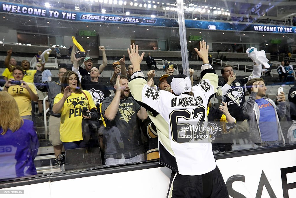 Carl Hagelin #62 of the Pittsburgh Penguins celebrates with fans after their 3-1 victory to win the Stanley Cup against the San Jose Sharks in Game Six of the 2016 NHL Stanley Cup Final at SAP Center on June 12, 2016 in San Jose, California.