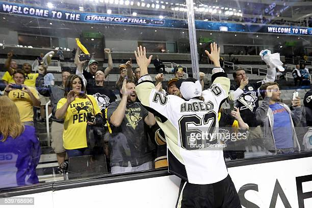 Carl Hagelin of the Pittsburgh Penguins celebrates with fans after their 31 victory to win the Stanley Cup against the San Jose Sharks in Game Six of...