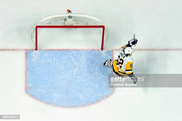 Carl Hagelin of the Pittsburgh Penguins scores a empty net goal during the third period against the Nashville Predators in Game Six of the 2017 NHL...