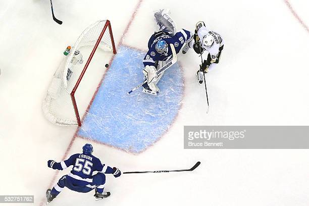 Carl Hagelin of the Pittsburgh Penguins scores a goal during the second period against Andrei Vasilevskiy of the Tampa Bay Lightning in Game Three of...