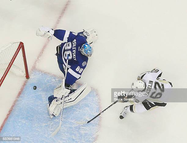 Carl Hagelin of the Pittsburgh Penguins scores on Andrei Vasilevskiy of the Tampa Bay Lightning in Game Three of the Eastern Conference Final during...
