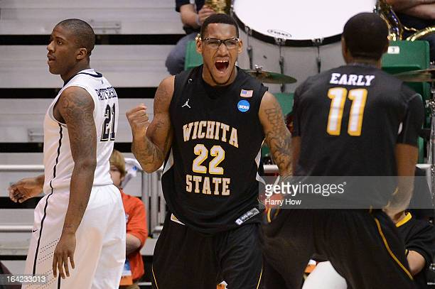 Carl Hall celebrates with teammate Cleanthony Early of the Wichita State Shockers after Hall scores and is fouled in the second half against the...