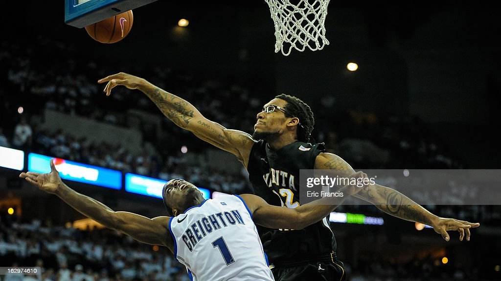 Carl Hall #22 of the Wichita State Shockers blocks the shot of <a gi-track='captionPersonalityLinkClicked' href=/galleries/search?phrase=Austin+Chatman&family=editorial&specificpeople=8839217 ng-click='$event.stopPropagation()'>Austin Chatman</a> #1 of the Creighton Bluejays during their game at the CenturyLink Center on March 2, 2013 in Omaha, Nebraska.