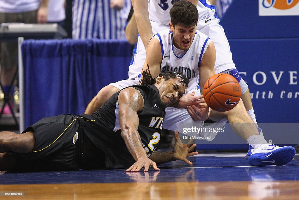 Carl Hall of the Wichita State Shockers dives for a loose ball against Avery Dingman of the Creighton Bluejays during the championship game of the...