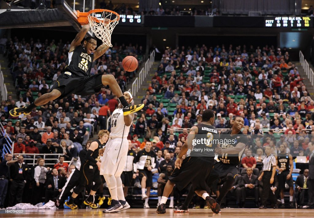 Carl Hall #22 of the Wichita State Shockers dunks the ball against J.J. Moore #44 of the Pittsburgh Panthers in the second half during the second round of the 2013 NCAA Men's Basketball Tournament at EnergySolutions Arena on March 21, 2013 in Salt Lake City, Utah.