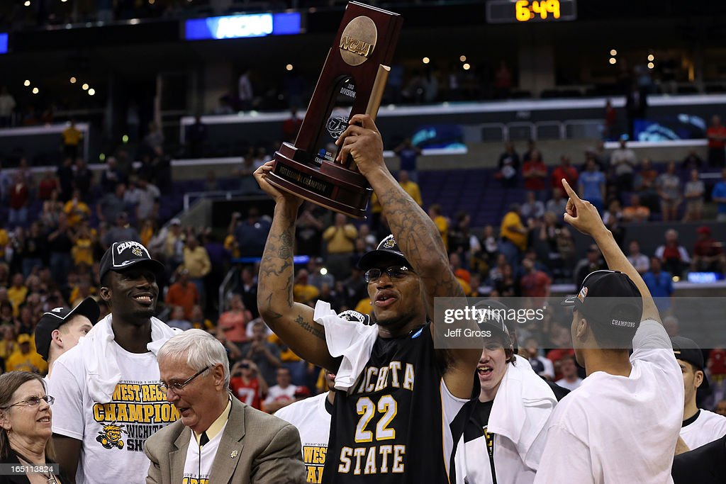 Carl Hall #22 of the Wichita State Shockers holds up the West Regional Trophy after defeating the Ohio State Buckeyes 70-66 during the West Regional Final of the 2013 NCAA Men's Basketball Tournament at Staples Center on March 30, 2013 in Los Angeles, California.
