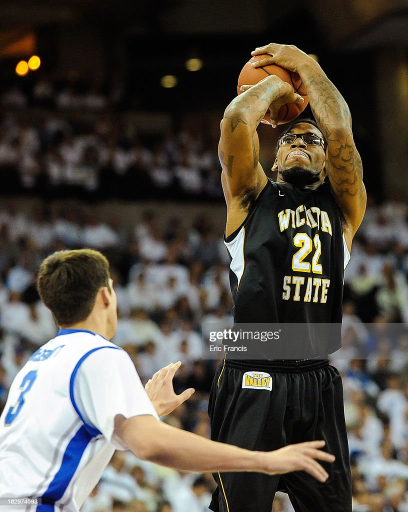 Carl Hall #22 of the Wichita State Shockers shoots over <a gi-track='captionPersonalityLinkClicked' href=/galleries/search?phrase=Doug+McDermott&family=editorial&specificpeople=7544468 ng-click='$event.stopPropagation()'>Doug McDermott</a> #3 of the Creighton Bluejays during their game at the CenturyLink Center on March 2, 2013 in Omaha, Nebraska.