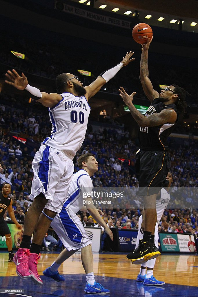 Carl Hall #22 of the Wichita State Shockers shoots the ball over <a gi-track='captionPersonalityLinkClicked' href=/galleries/search?phrase=Gregory+Echenique&family=editorial&specificpeople=5648736 ng-click='$event.stopPropagation()'>Gregory Echenique</a> #00 of the Creighton Bluejays during the championship game of the Missouri Valley Conference Tournament at the Scottrade Center on March 10, 2013 in St. Louis, Missouri.