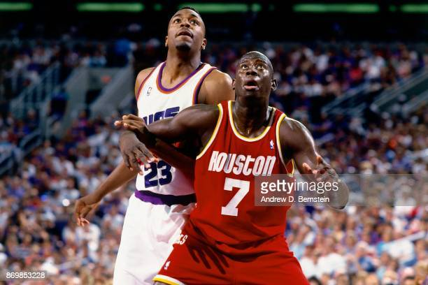 Carl Herrera of the Houston Rockets boxes out against Cedric Ceballos of the Phoenix Suns during Game Four of the Western Conference Semifinals...