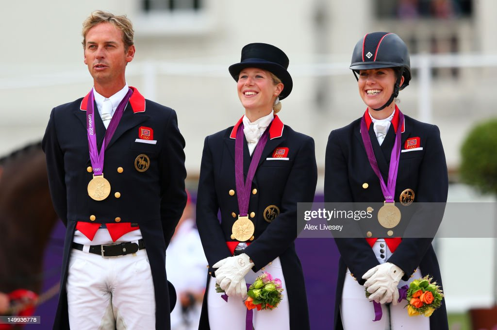 <a gi-track='captionPersonalityLinkClicked' href=/galleries/search?phrase=Carl+Hester&family=editorial&specificpeople=2298469 ng-click='$event.stopPropagation()'>Carl Hester</a>, Laura Bechtolsheimer and <a gi-track='captionPersonalityLinkClicked' href=/galleries/search?phrase=Charlotte+Dujardin&family=editorial&specificpeople=5426239 ng-click='$event.stopPropagation()'>Charlotte Dujardin</a> of Great Britain celebrate with their gold medals during the medal cerermony for the Team Dressage on Day 11 of the London 2012 Olympic Games at Greenwich Park on August 7, 2012 in London, England.