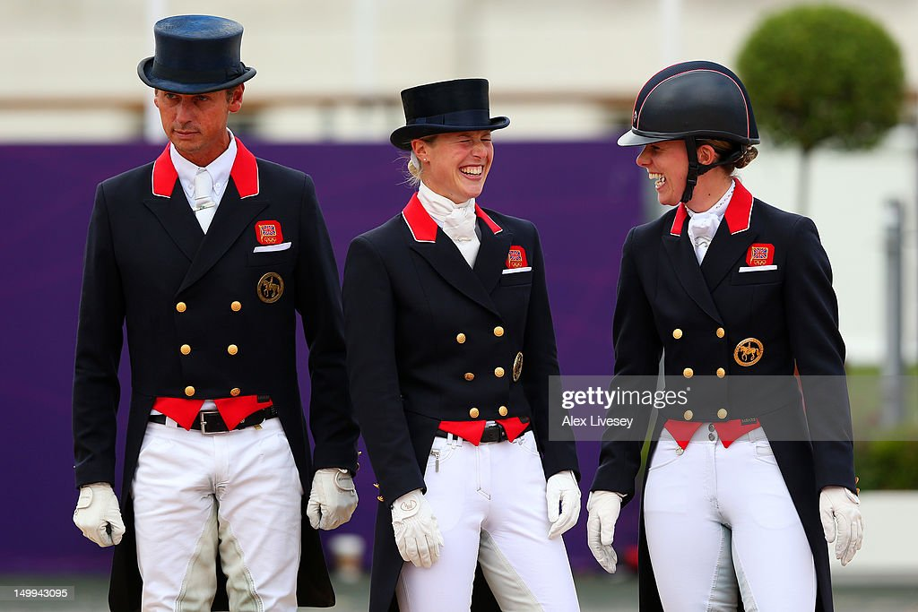 Carl Hester Laura Bechtolsheimer and Charlotte Dujardin of Great Britain celebrate before receiving their gold medals during the medal cerermony for...