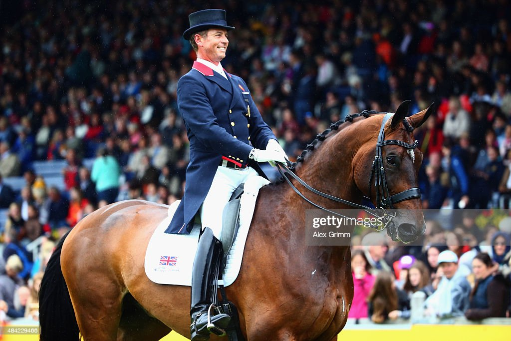 <a gi-track='captionPersonalityLinkClicked' href=/galleries/search?phrase=Carl+Hester&family=editorial&specificpeople=2298469 ng-click='$event.stopPropagation()'>Carl Hester</a> of Great Britain reacts after performing on his horse Nip Tuck during the Dressage Grand Prix Freestyle individual competition on Day 5 of the FEI European Equestrian Championship 2015 on August 16, 2015 in Aachen, Germany.