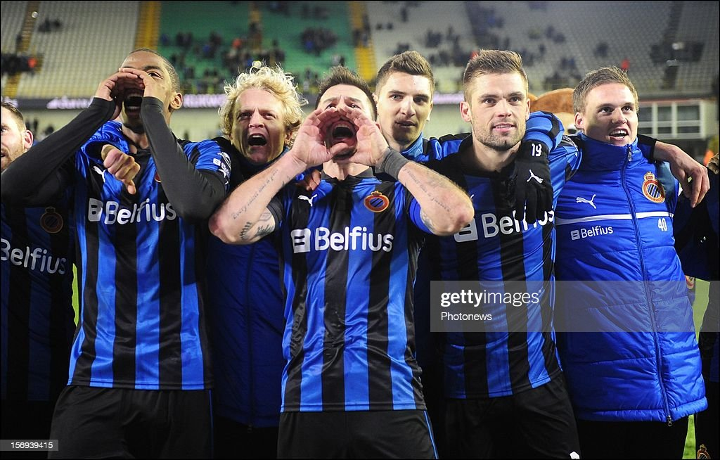 Carl Hoefkens of Club Brugge KV celebrates the win with teammates after the Jupiler League match between Club Brugge K.V and R.C.S.Charleroi November 25, 2012 in Brugge, Belgium.