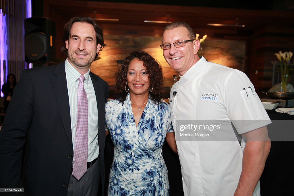Carl J Reyes Krystal Robinson and Robert Irvine attends the Robert Irvine Cooking Demonstration Reception at Greektown Casino's Brizola Restaurant on...